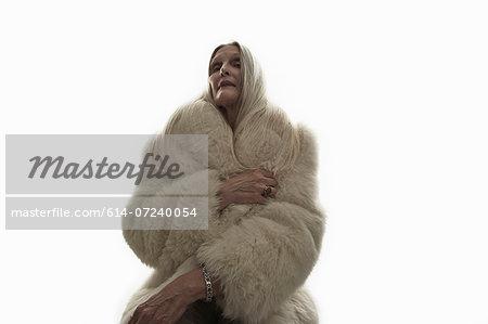 Studio shot of mature woman looking down