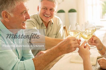 Senior friends toasting wine glasses