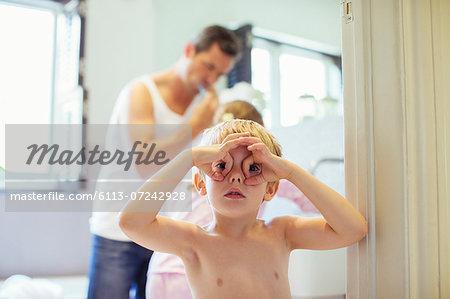 Boy making face in bathroom