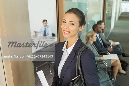 Businesswoman smiling in office doorway