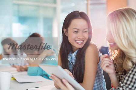 University students using digital tablet in classroom