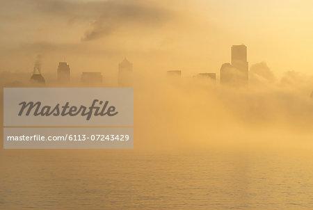 Fog over city skyline