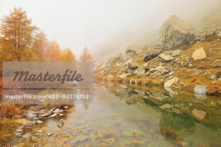 Mountain Lake with Fog in Autumn, Grindjesee, Findeln, Zermatt, Alps, Valais, Switzerland