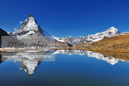 Matterhorn reflected in Lake Riffelsee, Zermatt, Alps, Valais, Switzerland