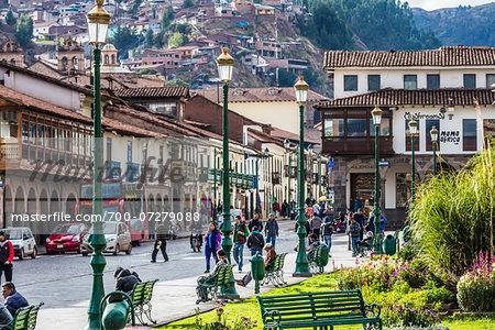 People on city street and buildings at Plaza de Armas, Cusco, Peru