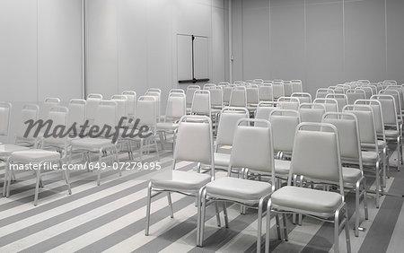 White chairs in empty auditorium
