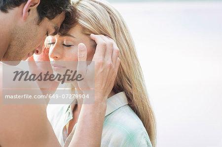 Young man touching woman's face