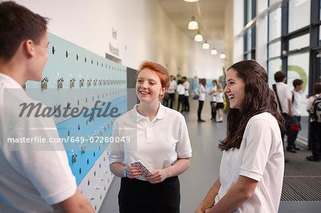 Teenagers chatting in school corridor