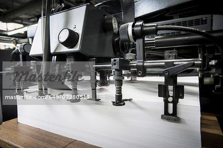 Paper prepared in printing machine in print workshop