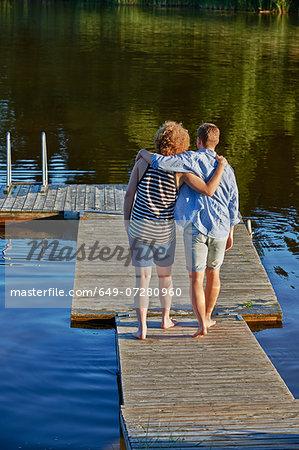 Two male adult friends strolling on pier, Gavle, Sweden