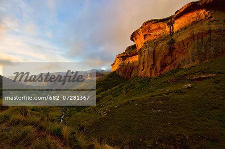 Sunset on Mushroom Rock above meandering stream in Golden Gate Highlands National Park, Free State Province, South Africa