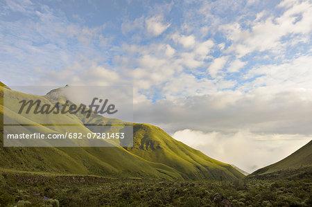 Intunja Peak with a grassy valley below, Monk's Cowl, Kwazulu-Natal, South Africa.