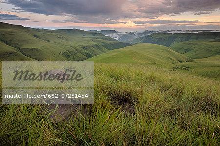 Grassy slopes of the Lower Drakensberg in the Mdedelo Wilderness, Drakensburg mountains, Kwazulu-Natal, South Africa.