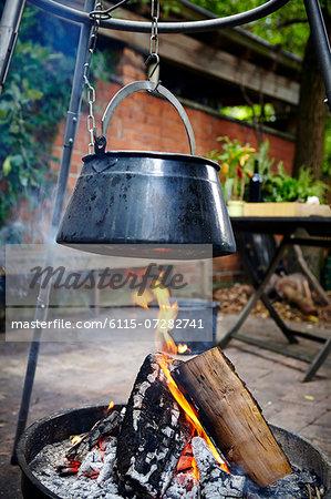 Cooking Pot Hanging On Hook Over Bonfire