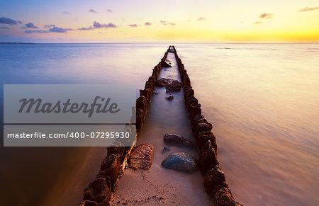 long wooden dike in North sea at sunset, Hindeloopen, Friesland
