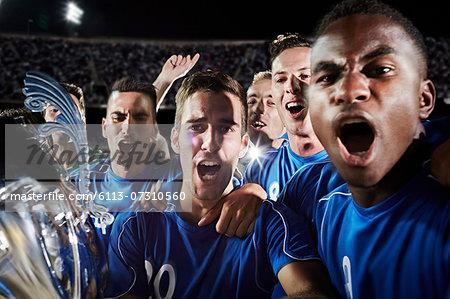 Soccer team cheering on field