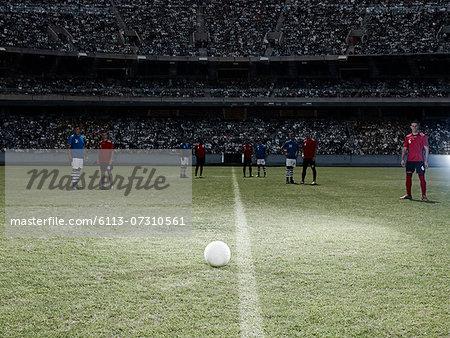 Soccer ball sitting on field
