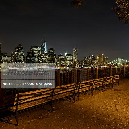 Park benches along Brooklyn Bridge promenade, Brooklyn, with view of Lower Manhattan skyline, New York City, New York, USA
