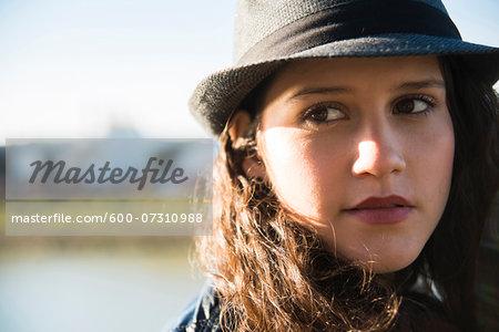 Close-up portrait of teenage girl wearing fedora, Germany
