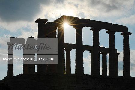 Silhouette of Temple of Poseidon at Sounion against sun, Acropolis, Athens, Greece