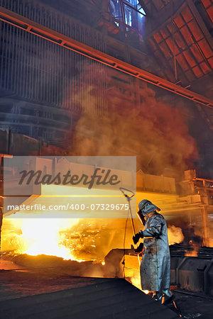 steel worker and hot steel