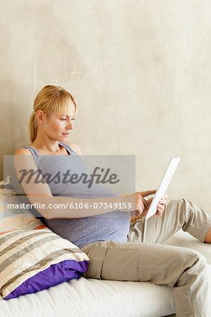 Pregnant Woman Using Digital Tablet