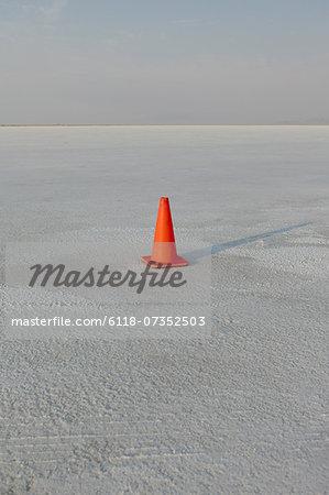 Traffic cone on salt flats, during Speed Week