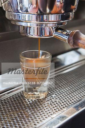 Espresso shot being poured from espresso machine, Seattle
