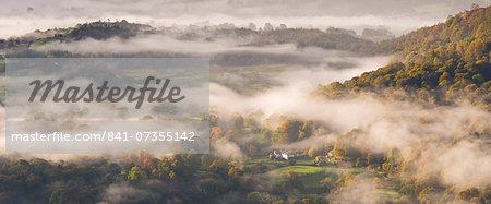 Mist covered landscape in autumn, Lake District National Park, Cumbria, England, United Kingdom, Europe