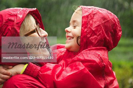 Grandmother and Granddaughter Hugging in the Rain