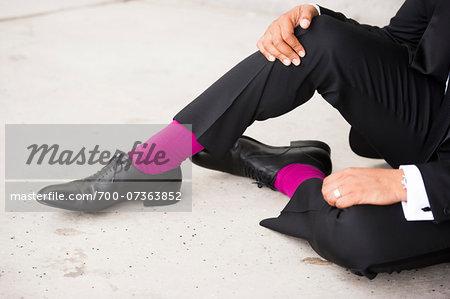 Groom from Waist Down wearing Fuchsia Socks