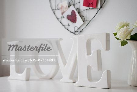 Wooden 'love' letters decoration, roses on desk
