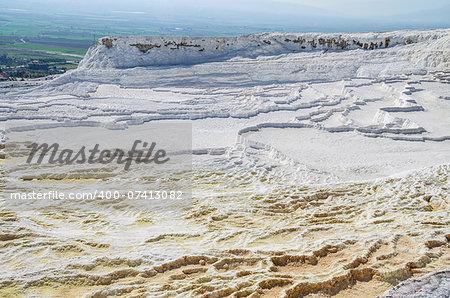 Dry yellow and white travertines in Pamukkale, Turkey