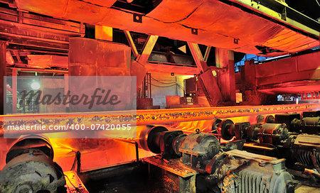 hot steel on conveyor inside of plant