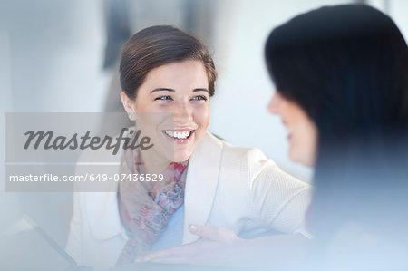 Businesswomen having conversation