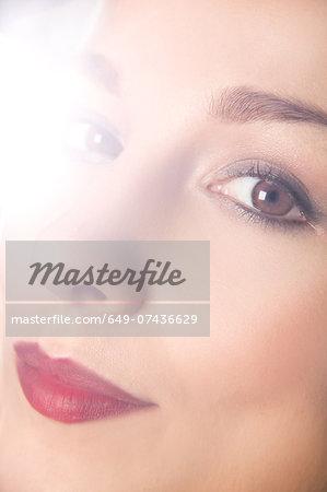 Close up studio portrait of young woman's face