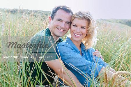 Mid adult couple in sandunes, Thurlestone, Devon, UK