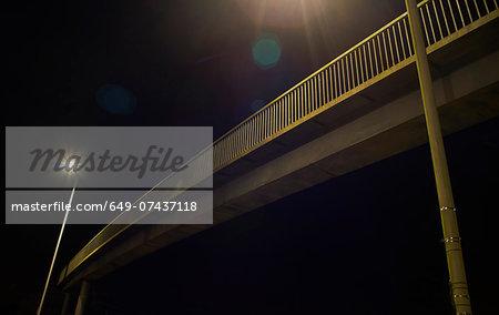 Pedestrian footbridge at night