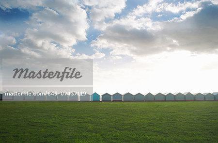 Row of coastal beach huts, Sussex, United Kingdom