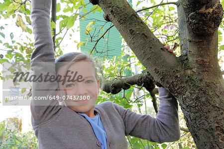 Portrait of teenage girl in garden