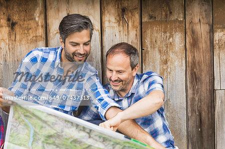 Men reading map