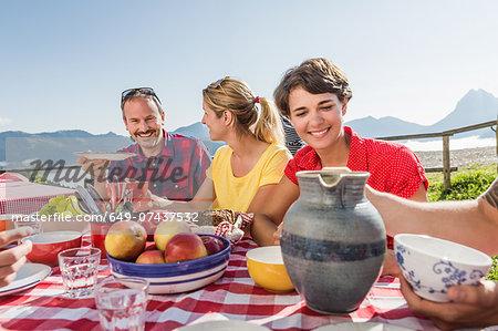 Friends enjoying breakfast, Tyrol, Austria