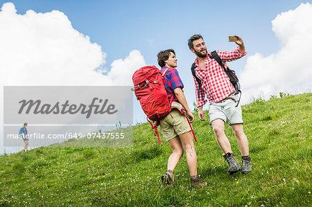 Young adults hiking, Tyrol, Austria