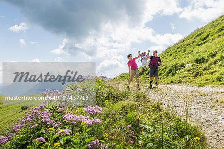 Parents and daughter having fun on walk, Tyrol, Austria