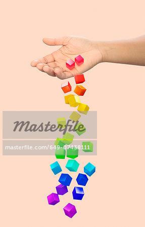 Hand dropping multi coloured blocks
