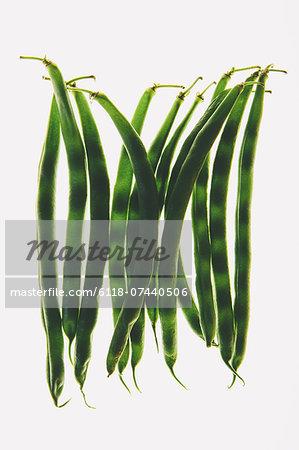 Organic green string beans on white background