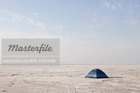 A blue tent on Bonneville Salt Flats at dusk.