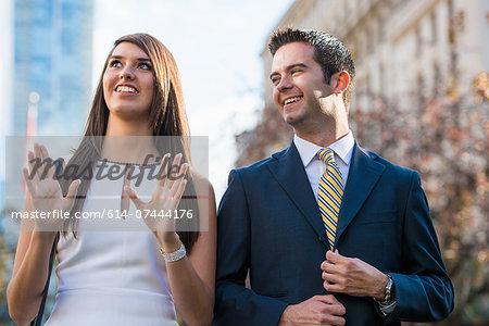 Smart young couple on city street, Toronto, Ontario, Canada