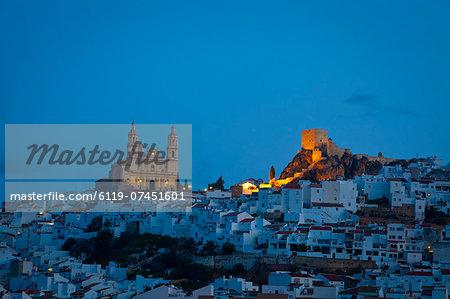 The hilltop village of Olvera illuminated at dawn, Olvera, Cadiz Province, Andalusia, Spain, Europe