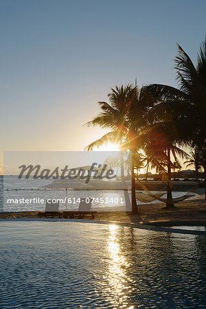 Sunset at coastal resort, Providenciales, Turks and Caicos Islands, Caribbean